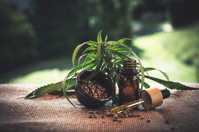 marijuana seeds and thc oil bottle