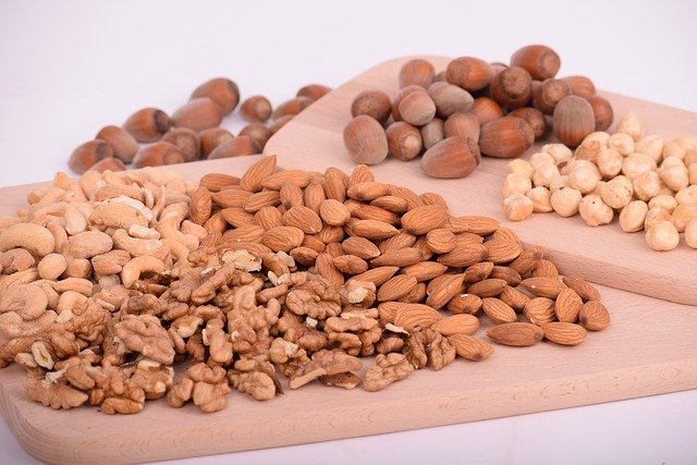 mixed nuts on a wooden board
